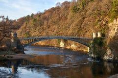 Craigellachie Bridge designed by Thomas Telford, on the river Spey. Craigellachie, Scotland: 17th December 2018 - A listed cast iron Craigellachie Bridge on the royalty free stock photos