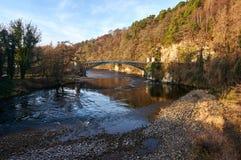 Craigellachie Bridge designed by Thomas Telford, on the river Spey. Craigellachie, Scotland: 17th December 2018 - A listed cast iron Craigellachie Bridge on the stock photos