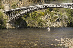 Craigellachie Bridge over the River Spey in Scotland. Thomas Telfords Craigellachie Bridge over the River Spey at Craigellachie in Scotland Stock Images