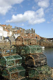 Crail harbour and lobster pots Stock Images