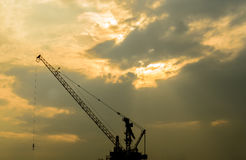 The Crain. Has under construction under the lighting sky in the evening Stock Image