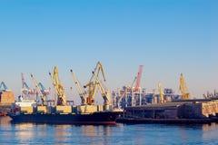 Craine ship loading cargo from a bigger ship in Leith Docks stock photos