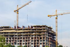 Crains on construction site of building. Construction background Royalty Free Stock Image