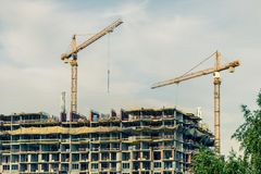 Crains on construction site of building. Construction background Stock Image