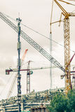 Crains on construction site of building. Construction background Royalty Free Stock Photos