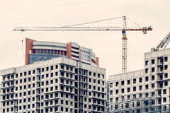 Crains on construction site of building. Construction background Royalty Free Stock Photo