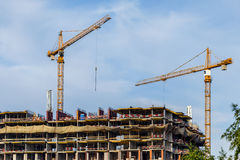 Crains on construction site of building. Construction background Stock Photography