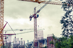 Crains on construction site of building. Construction background Royalty Free Stock Photography