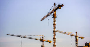Crains on a new construction site of high-rise building Stock Image