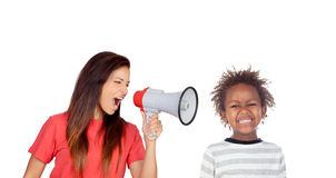 Craizy mum shouting by a megaphone to her son Royalty Free Stock Image