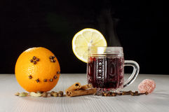 Craizy orange smile and red hot winter wine gluhwein Stock Photography