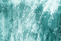 Craked weathered cement wall texture in cyan tone. Abstract background and texture for design royalty free stock photos