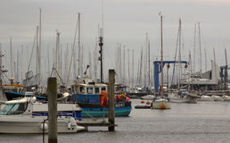 The crammed marina at Lymington Harbour home to the Royal Lymington Yacht Club. Taken on a dull grey summer`s day in June Stock Image