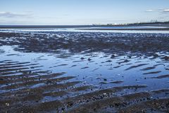 Cramond Island, Edinburgh, Scotland - the beach at low tide. This image shows a view Cramond Island, Edinburgh, Scotland. It was taken on a sunny day in summer stock photography