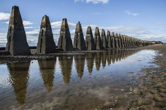 Cramond Island, Edinburgh, Scotland, the UK - a row of concrete pylons. This image shows a view Cramond Island, Edinburgh, Scotland, the UK. It was taken on a stock photos
