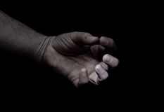 Cramped hand. A cramped hand , or a hand palm in spasm , grunge style royalty free stock photos