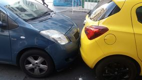 Cramped parking. Spaces in downtown areas definitely cost drivers money in repairs. The photo was taken in Madrid stock images