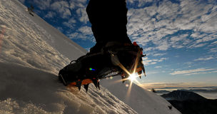Crampon. Of a ascending mountaineer Stock Photo