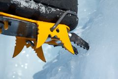 Crampons close-up on his feet ice climber, climber on a frozen waterfall.  royalty free stock image