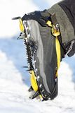 Crampons closeup. Crampon on winter boot for climbing, glacier walking or hiking and trekking on ice and hard snow royalty free stock photo