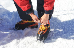Crampons closeup. Crampons closeup. Crampon on winter boot for c. Limbing, glacier walking or extreme hiking on ice and hard snow Royalty Free Stock Photo