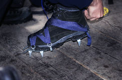 Crampons closeup. Crampons closeup. Crampon on winter boot for c. Extreme hiking on ice snow Stock Photography