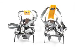 Crampons on a white background. Climbing equipment, a pair of metal crampons Royalty Free Stock Images