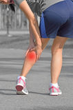 Cramps in leg calves or sprain calf. On woman runner royalty free stock photo