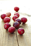 Cranberries. Fresh cranberries on wooden background Royalty Free Stock Photography