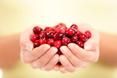 Cranberries. Woman showing . Healthy eating and berry concept stock photos