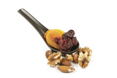 Cranberries and Apricots on a Spoon Royalty Free Stock Images