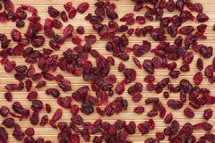 Cranberries on the bamboo mat Royalty Free Stock Images