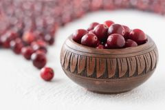 Cranberries in a bowl on white background stock images