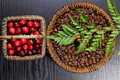 Cranberries and coffee beans. In baskets Royalty Free Stock Photos