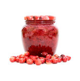Cranberries and cranberry jam. Closeup on white background Royalty Free Stock Images