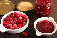 Cranberries and cranberry jam. Royalty Free Stock Photos