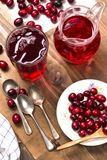 Cranberries and cranberry juice in a glass stock photos