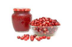 Cranberries in a glass bowl and cranberry jam. On a white background Stock Photos