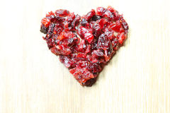 Cranberries heart. Many Cranberries on a spoon Stock Image
