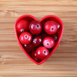 Cranberries in a heart bowl Stock Photography