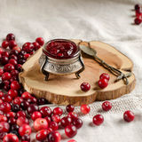 Cranberries and jam in a silver jar Royalty Free Stock Image