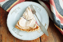 Cranberries meringue tart on the plate Royalty Free Stock Photography