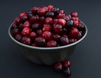 Cranberries in Metal Bowl from above against a black background Stock Photos
