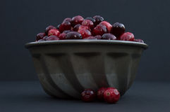 Cranberries in Metal Bowl with Berries Out of Bowl Royalty Free Stock Images