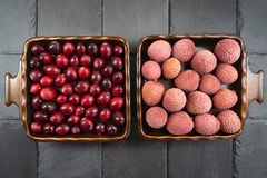 Lychee and cranberry fruit in two square bowls stock photo