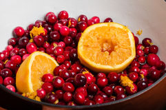 Cranberries and orange making cranberry sauce Royalty Free Stock Photography