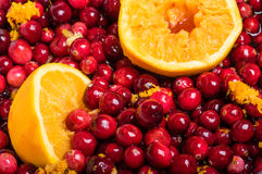 Cranberries and orange making cranberry sauce Royalty Free Stock Photo