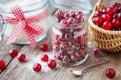 Cranberries with sugar, basket with berries and sugar bowl Stock Photo