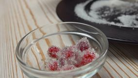 Cranberries in sugar and stored in a bowl. Cranberries in sugar and stored in a glass bowl stock footage