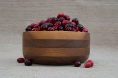 Cranberries in Wood Bowl with Berries Out of Bowl Stock Images
